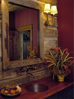 Bathroom vanity with rustic woods, copper wall faucet, copper sink, wood countertop