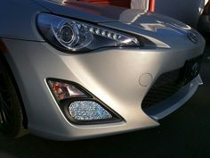 DIY fog light cover overlay for the Scion FRS made with silver fish scale spandex and cardboard