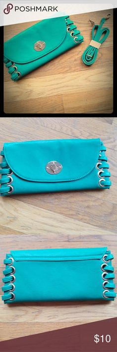 NWOT Charming Charlie Green Clutch Super cute little clutch, never been used!! Small but has shoulder strap with it and can be converted from clutch to cross body. NEVER USED!! 1 small zipper pocket on the inside. Silk liner. Charming Charlie Bags Clutches & Wristlets