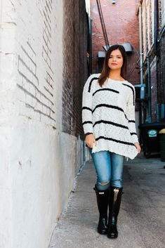Black and White Chunky Knit Sweater, Distressed Blue Jeans, Black Original Gloss Hunter Boots | Maryssa Albert Blog