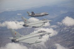 Apr. 4, 2014,near Edwards AFB,California.a Lockheed Martin F-35 Lightning II of Integrated Test Force with 2 Eurofighter Typhoon IIs of Royal Air Force during an interoperability test.A mixed formation of this kind,with the U.S. & Europe's most advanced warplanes,still quite rare,but should be more frequent,at least in UK & Italy,since both Royal Air Force & Italian Air Force are not only already flying Typhoon,but plans to fly F-35.