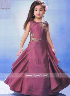 fd9a8e445a5 Gorgeous yet stylish this Wine color designer Gown made from Silk fabric.  This sleeveless readymade Gown is enhanced with golden embroidery work on  it.