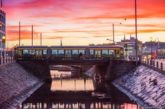 Helsinki: A new Artic tram on the old bridge crossing the canal between the districts of Katajanokka and Kruununhaka. By 2018 there will be a total of 40 new trams in traffic. December 2014, My Land, Helsinki, Travelling, Cities, Bridge, Old Things, Heaven, Sky