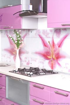 #Kitchen Idea of the Day: Kitchen backsplash materials: tile, stone, metal, glass, and more. This one's quite PINK!