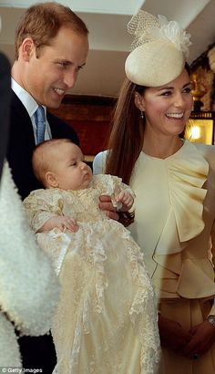 Prince William, Duchess Catherine and Prince George.  Where: Chapel Royal for Prince George's Christening. Dress: Alexander McQueen
