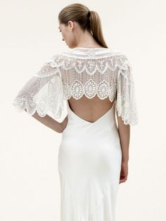 Jenny Packham, Elsa - bridal cover up http://goodbyemiss.com/wedding/2014-wedding-dress-trends-cover-ups