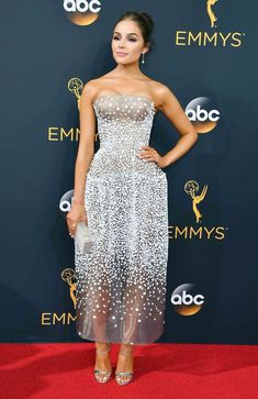 2016 Emmys: Olivia Culpo in a semi-sheer strapless gown by Zac Posen paired with silver Casadei sandals