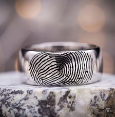 We've made several fingerprint wedding rings recently, inspired by one of our past customer's viral stories about designing his ring with his future wife's fingerprint on the surface. What's most fun is how each ring, starting from similar inspiration, ends up with a slightly different and personal take on this sweet concept!