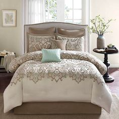 Refresh your master suite or guest room in classic style with this lovely comforter set, showcasing a scrolling motif for charming appeal.  ...