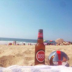 Die #MOTORDIALOG #Kugel #onTour in #Portugal! #Zusammen mit einer #Flasche #SuperBock liegt die #instaKugel am #Strand und verbringt einen #tollen #Urlaubstag am #Meer. #Sand #Handtuch #Sonne #instaSun #sun #instaGood #placetobe #Ocean #Ausrufezeichen #Wellen #Welle #Sonnenmilch #Sonnencreme #Sonnenbaden #Urlaub #Strandurlaub @ig_great_pics #ig_great_pics