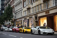 On display: A row of stunning supercars line up outside designer shops Versace and Fendi i...