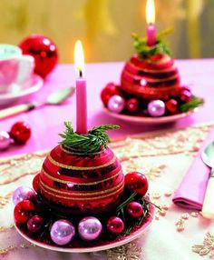 Do away with traditional candleholders and use Christmas ornaments instead. This will give Christmas candles a fresh and, lively twist. Christmas Table Decorations, Christmas Candles, Pink Christmas, All Things Christmas, Vintage Christmas, Christmas Holidays, Christmas Ornaments, Deco Table Noel, 242