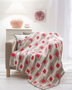 Add a modern touch to your home with this Graphic Gridwork Afghan featuring pop color accents. Shown in Waverly for Bernat.