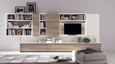 Open bookcases and entertianment consoles shape the trendy wall unit