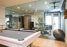 Basement Gym. Basement Gym Design. The basement also features an amazing gym with full wall of glass. #Basement #gym Brandon Architects, Inc. Churchill Design. Legacy CDM Inc.