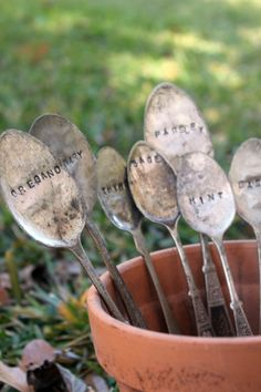 spoon labels for the garden – hammer spoons between 2 pieces of wood, use metal stamps
