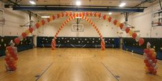 8th grade dance criss-cross arch by www.Total-Party.com. Transform any gym with this balloon decor to any theme!