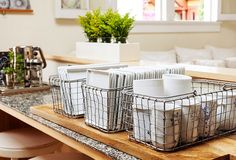 A smart idea for storage and entertaining: Morris keeps plates and mugs organized in metal baskets.