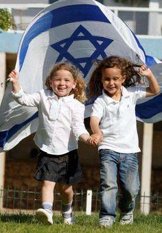 Happy children with the Israeli flag