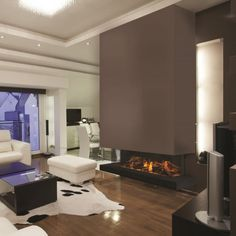 The by Electric Modern is a stunning, corner style electric fireplace. A fireplace for someone who wants a centerpiece for a fashionable space. Features the most realistic electric flame effects available. Electric Fires, Grey Lounge, Hd Led, Wood Fireplace, European House, Electric Fireplace, Modern Design, New Homes, Corner