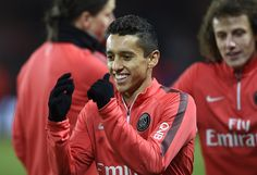 Paris Saint-Germain's Brazilian defender Marquinhos smiles as he warms up ahead of the French L1 football match between Paris Saint-Germain (PSG) and Rennes (SR) at the Parc des Princes stadium in Paris on January 30, 2015.