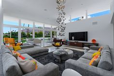 There are two beautiful mid-century living rooms in this one house - one indoors and one outdoors. And it gave the designer two separate spaces to work with. Palm Springs-based...