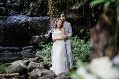 Ashton and Adam sharing a private moment prior to their waterfall elopement in Costa Rica by Costa Vida Photography