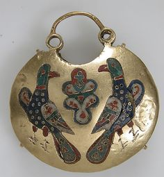 Temple Pendant with Two Birds Flanking a Tree of Life (front) and Geometric and Vegetal Motifs (back) Date: 11th–12th century Geography: Made in, Kiev Culture: Kievan Rus' Medium: Cloisonné enamel, gold Dimensions: Overall: 2 1/8 x 1 7/8 x 9/16 in. (5.4 x 4.8 x 1.5 cm) Classification: Enamels