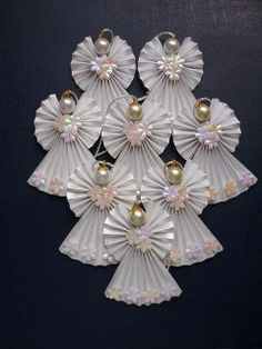 How to make a paper angel for the christmas ornament more articles Origami Angel ornaments By rheajm (No other information. Origami Angel made with 3 one dollar bills. Each wing is a origami angels…cute ornaments or gift tag, decoration. Divine And Beau Christmas Angels, All Things Christmas, Christmas Holidays, Christmas Decorations, Christmas Ornaments, Origami Christmas, Crochet Christmas, Paper Decorations, Birthday Decorations