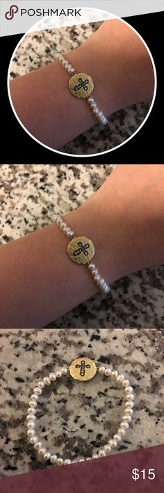 Girls Pink Cross Bracelet 💕 Never been worn, stretches so one size fits most - made for a child size but fits me (pic) - light pink pearls with cross on gold toned chart in CZ Jewelry Bracelets