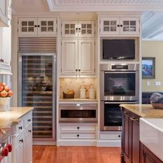 Love the way the upper cabinets look. Would love to do something like that in my apartment to make the units look built in.