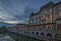 Photograph by Stuart Litoff.  #Reflections at #dawn in the #LjubljanicaRiver, in #Ljubljana, #Slovenia