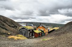 Mining village of Røros, Norway. Old miners' cottages nestle between slag heaps.