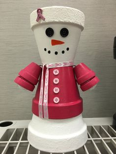 Snowman Breast Cancer SALE Clay Pot People  Holiday Christmas Snow Xmas Decor Decoration Unique Flower by GARDENFRIENDSNJ on Etsy https://www.etsy.com/listing/479797012/snowman-breast-cancer-sale-clay-pot