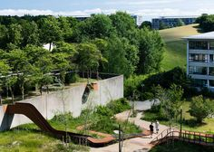 Holscher Nordberg Architects frames play area with metal ribbon