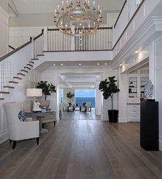 Foyer lighting- Foyer lighting ideas- High ceiling foyer lighting- I think this is beautiful! I love the wide, open, grand space! Perfection!