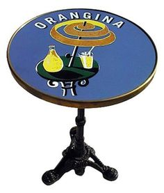 """Orangina French Enamel Tabletop Bistro Table by Glac Seat Inc. $759.99. 24"""" round tabletop. 28.5"""" height. 42 pounds. Orangina French Design. Sealed Melamine table top with brass ring. Add some color to your dining, kitchen, patio with this unique bistro table! This table top is hand made in France, the old fashion way. Each color is baked at 800 degrees Celsius which gives a strong finish to the tops even when used outdoor.  Table Weight and Dimensions  Product Specifications  3..."""