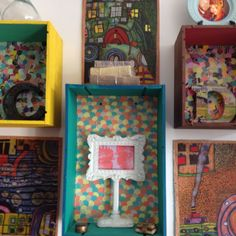 Wine crates and Hundertwasser prints on soft wood