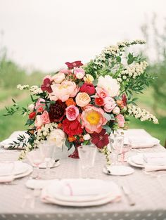 Beautiful wedding table flowers by Tricia Egan of Violet Floral Design // Photo: Sara Hassted