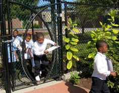 Ross Miller. seed shaped entrance gate from an outdoor schoolyard play space into the outdoor classroom