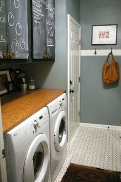 Stone Fence by Behr paint... chalkboard cabinets, front load washer and dryer with counter room on top... the white stripe that has hooks going around the room- LOVE this laundry!