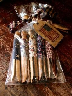 Vintage clothespin wrapped with Americana material and used as bowl fillers.