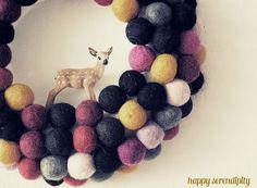 colorful felt balls + styrofoam wreath + sweet little deer pal = happy winter wreath