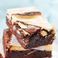 PHILADELPHIA Marble Brownies:         ingredients: 1   pkg. (19 to 21 oz.)brownie mix (13x9-inch pan size)   1   pkg. (8 oz.)PHILADELPHIA Cream Cheese, softened,   1/3   cupsugar,   1   egg,   1/2   teaspoonvanilla.  Directions:   HEAT oven to 350 degrees F.   PREPARE brownie batter as directed on package; spread into greased 13x9-inch pan.   BEAT cream cheese with mixer until creamy. Add sugar, egg and vanilla; mix well. Drop by tablespoonfuls over brownie batter; swirl with knife…