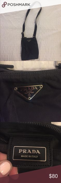 "Small Prada cross body purse Small black nylon cross body Prada bag. 6"" x 8"". Strap is adjustable and is 39"" at its longest. This is authentic and was purchased in the Prada store in 2003. I no longer have the dust bag it came with. This is the perfect travel bag to carry just a few small items. Bag is in excellent condition--it's slightly wrinkled from sitting in a bag in my closet but will come out with wear. Prada Bags Crossbody Bags"