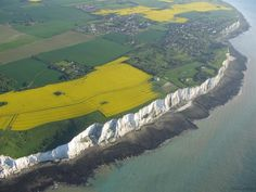 White Cliffs of Dover, England  These remarkable chalk cliffs plunge from the North Downs to the English Channel. Streaked with black flint, the cliffs have historical significance for Britain since they were the first defensive line between England and the rest of the continent...and the first sight of England for visitors entering by boat.