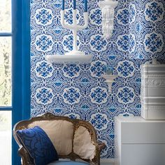 We love the cool blue tile-effect wallpaper and white accessories in this modern living room.
