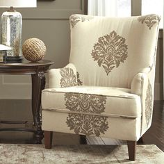 Like the fabric pattern and shape of the chair.