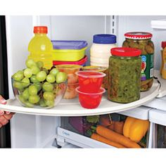 Need to grab something from the back of the fridge? It's easy with this Swing-Out Refrigerator Shelf! Solutions.com #Kitchen #Organization #Solutions