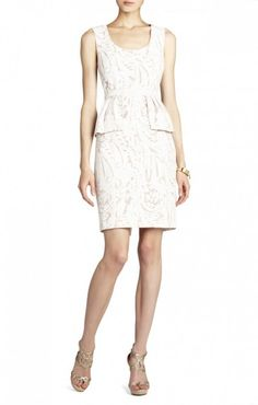 $175.00 Striking lace and an on-trend peplum make this sheath-dress a head-turning choice for the season's social events. Round neck. Sleeveless.Lace construction. Peplum at waist. Back slit.Concealed center back zipper with hook-and-eye closure.Lace: Cotton, Polyester. Crepe de Chine: Polyester.Dry Clean.Imported.